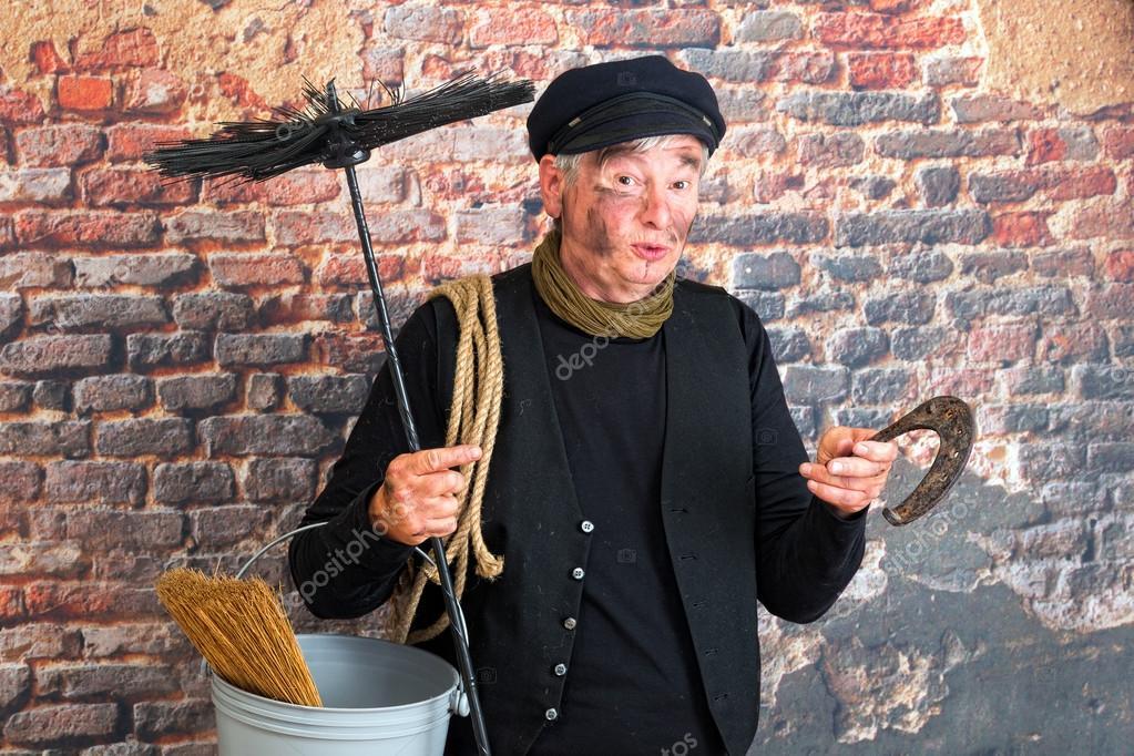 Chimney sweep with horseshoe
