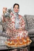 Fotografie Pouring tea the arab way