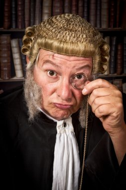 Judge with monocle