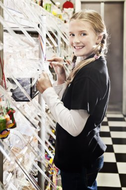 young girl in candy store