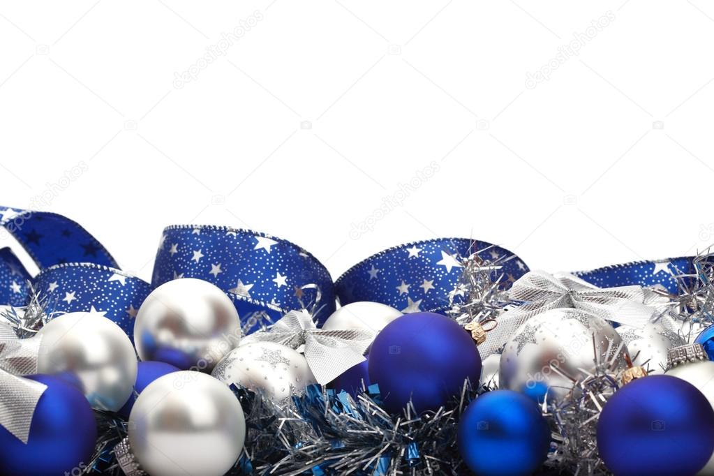 Silver And Blue Christmas Decorations Tree Adornments On White Background With Copy Space Above
