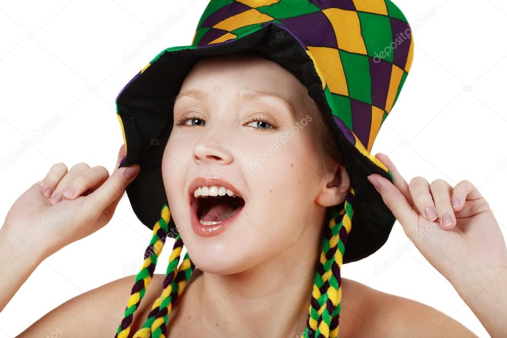 pretty blond girl in clown hat making faces stock photo