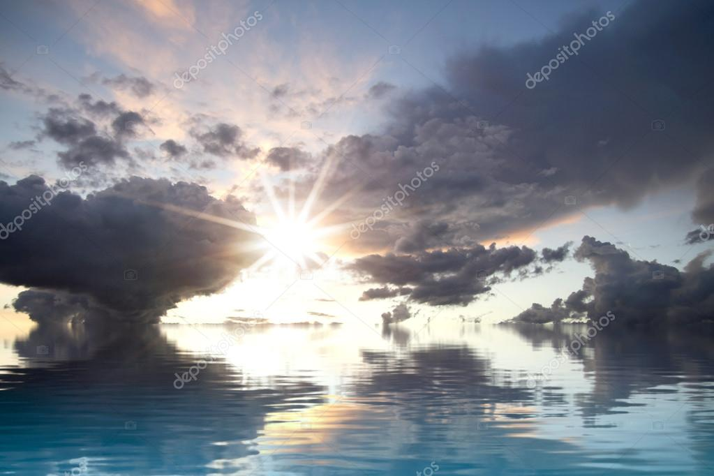 Dark storm with water reflection. A sky of clouds reflected in a