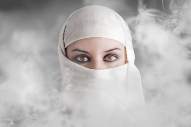 Arabic woman into smoke clouds
