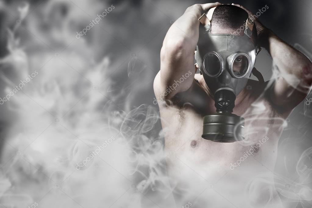 Portrait of a man in a polluted ambience with gas mask
