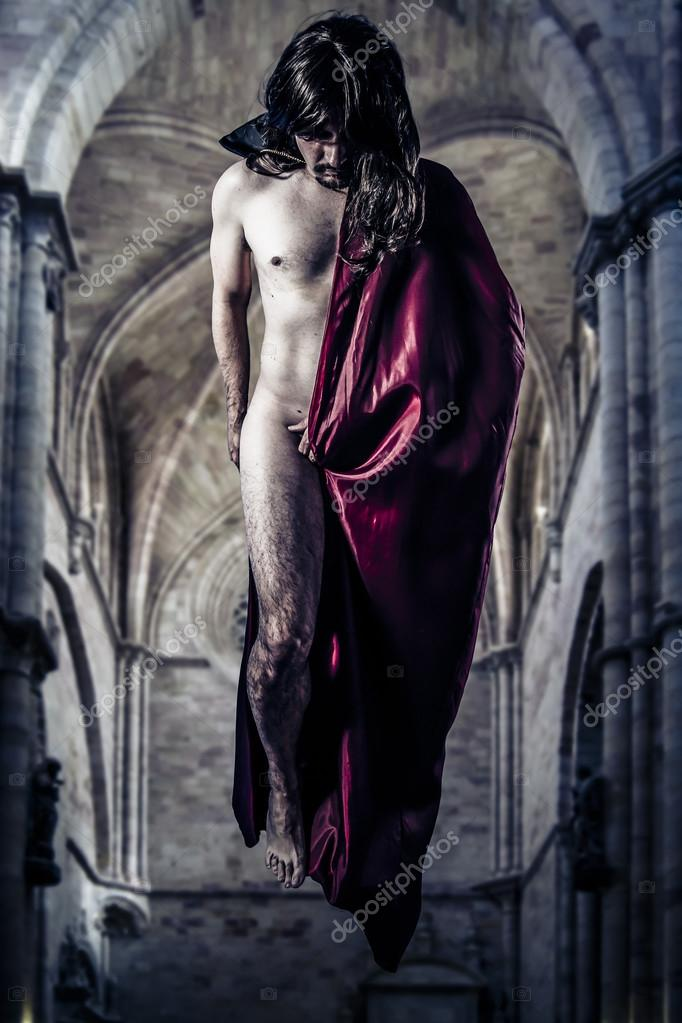 Nude magician levitating inside a Gothic cathedral — Stock Photo