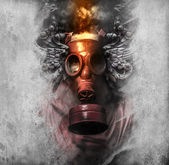 Photo Toxic. A man in a gas mask in the smoke.