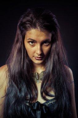 Warrior woman with golden mask, long hair brunette. Long ha