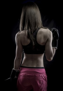 Healthy, strong woman athlete with boxing gloves