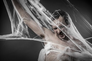 Man tangled in spider web