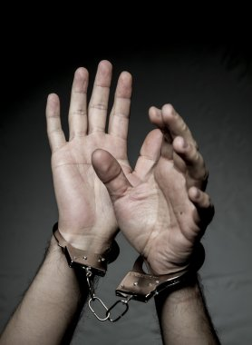 hands with handcuffs. Prison riot concept.