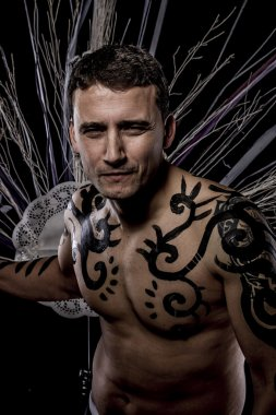 Young man with tribe tattoo