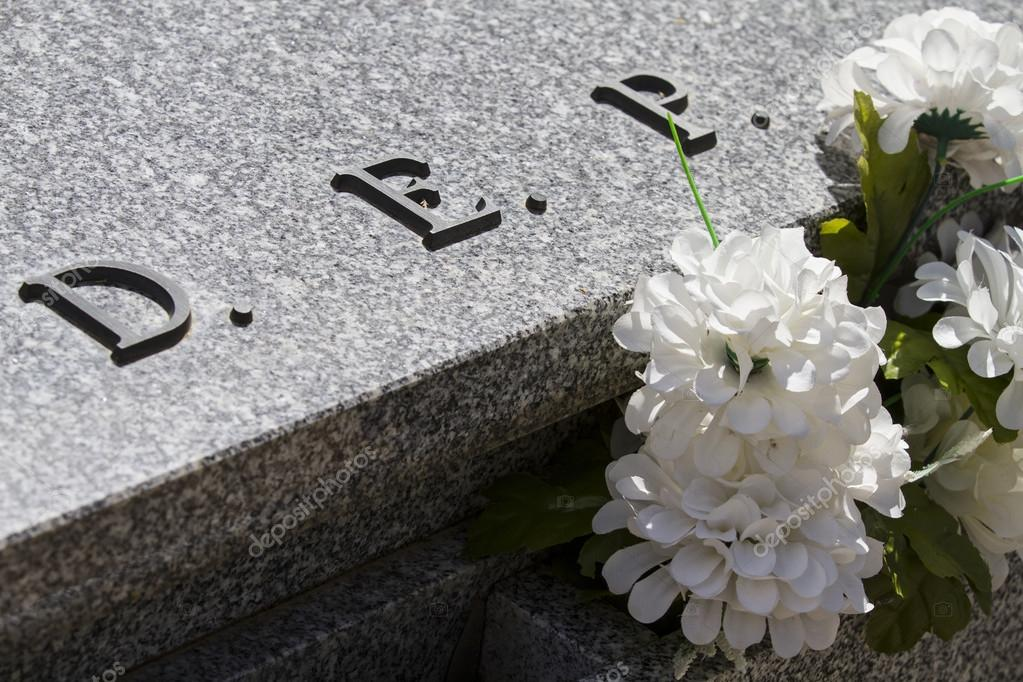 dep cemetery detail with white flowers stock photo outsiderzone