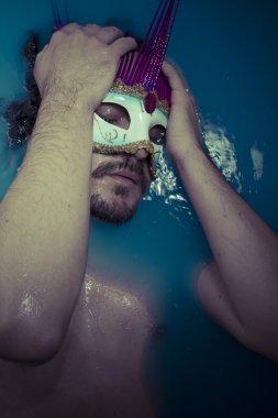 Man in blue tub full of water