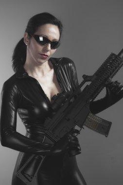 Brunette woman with gun
