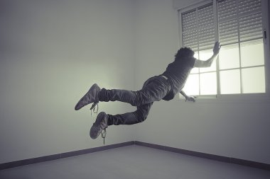 Man flying into a window