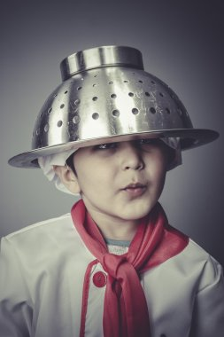Boy dressed as a cook