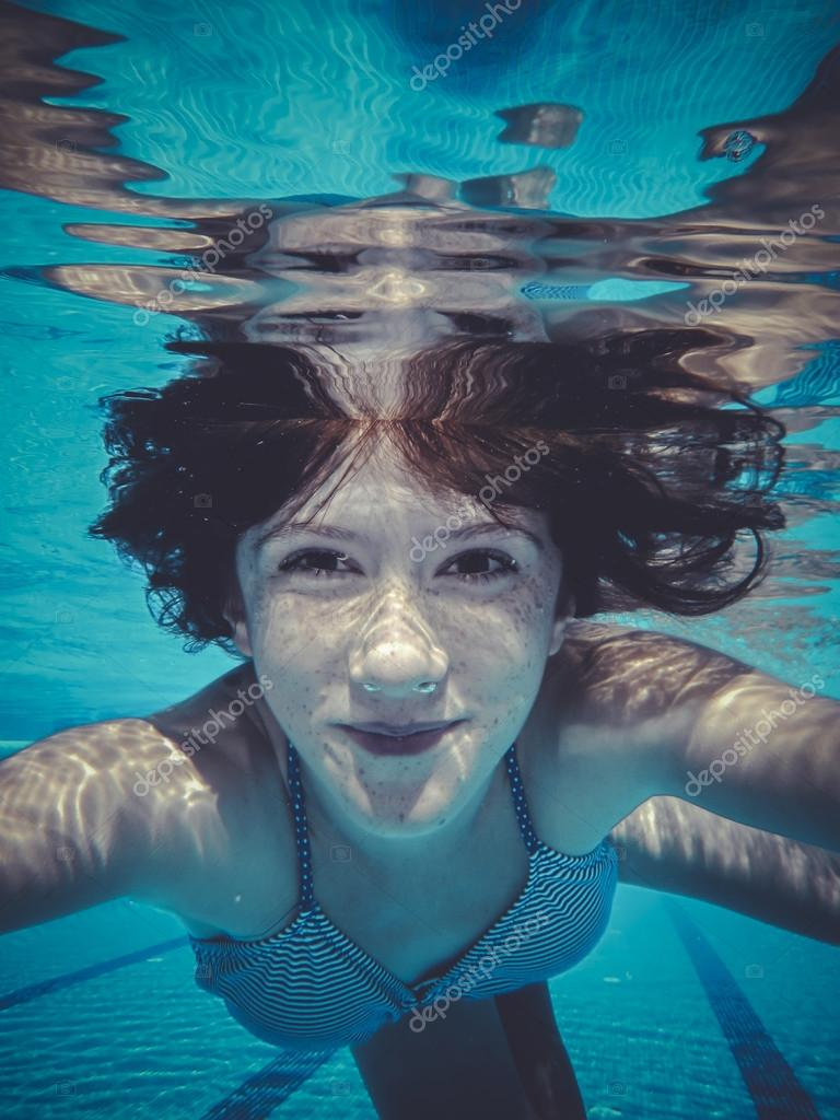 underwater, teenager diving into a pool