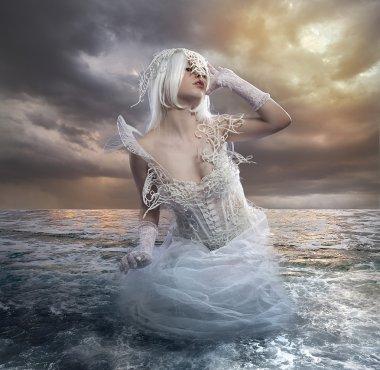 Blonde woman in sea