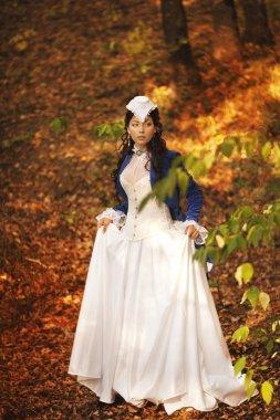 Woman at historical dress at park