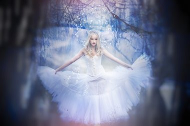 White queen with the wings in the forest