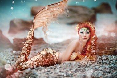 Mermaid on a sea