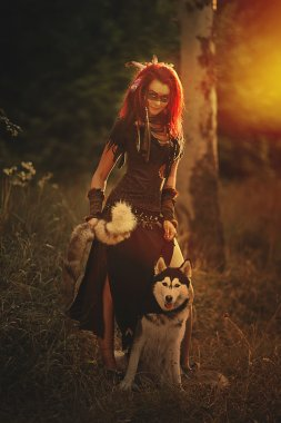 Shaman girl in the woods with the dog