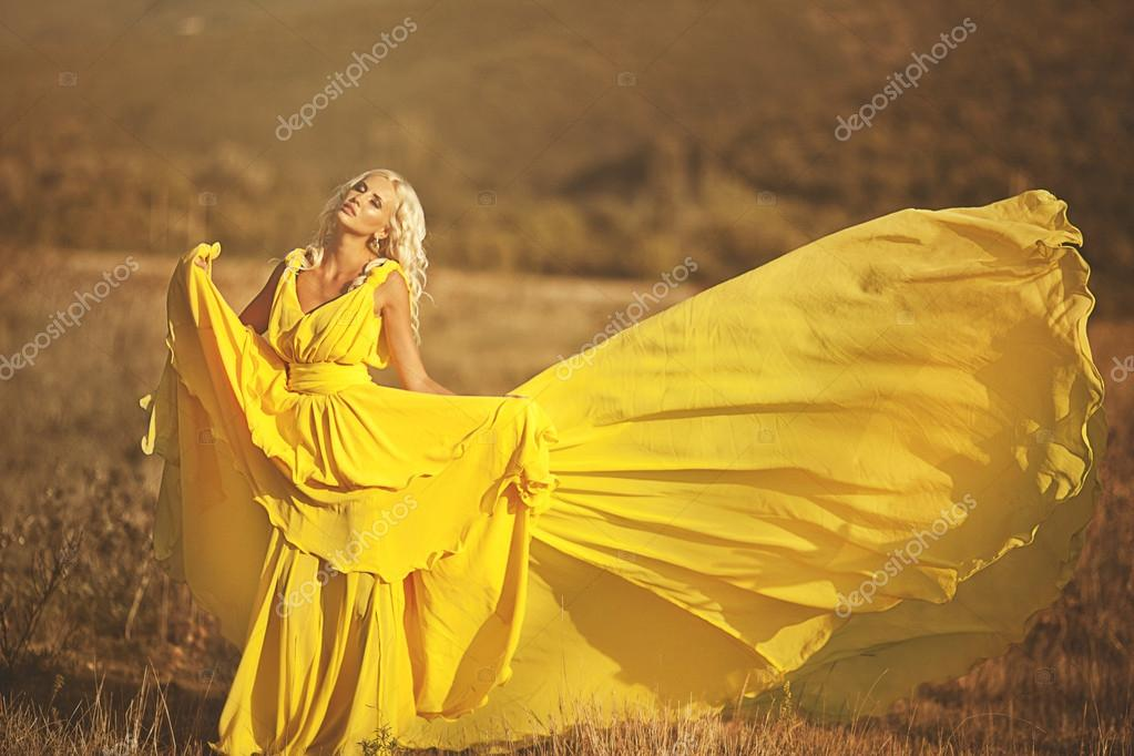 Beautiful girl in a yellow dress