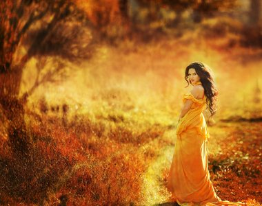 Beautiful girl in a yellow dress air