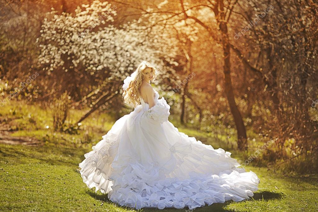 Blond bride in white
