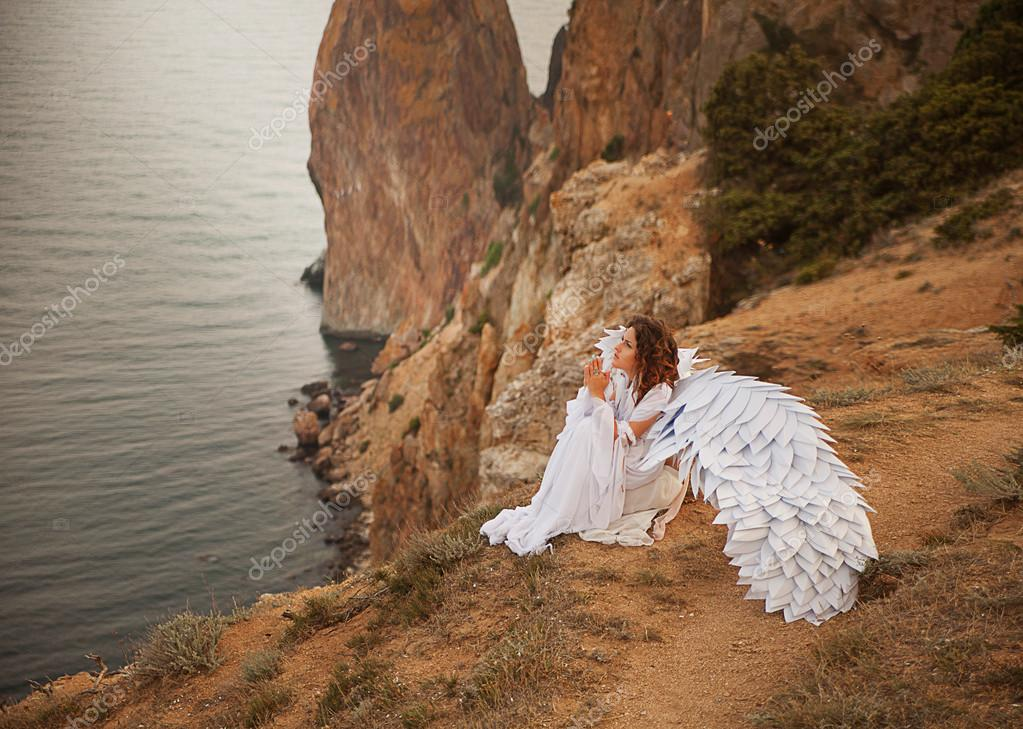 Woman with wings on mountain
