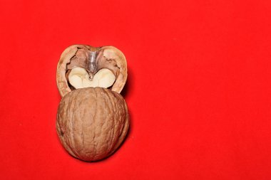 nut has broken in half, the two halves of the heart on a background, a card for Valentines Day