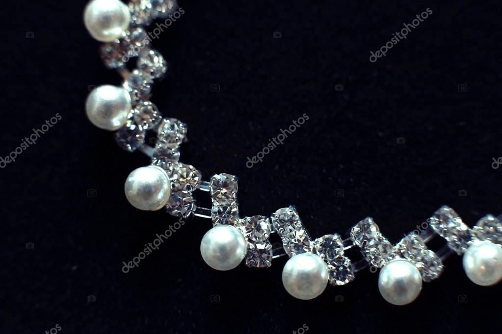 Beautiful jewelry on black background — Stock Photo © xload #22165847