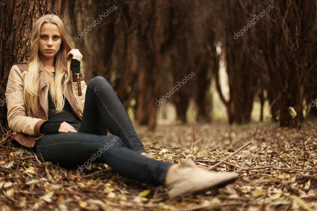 beautiful young girl in the autumn forest