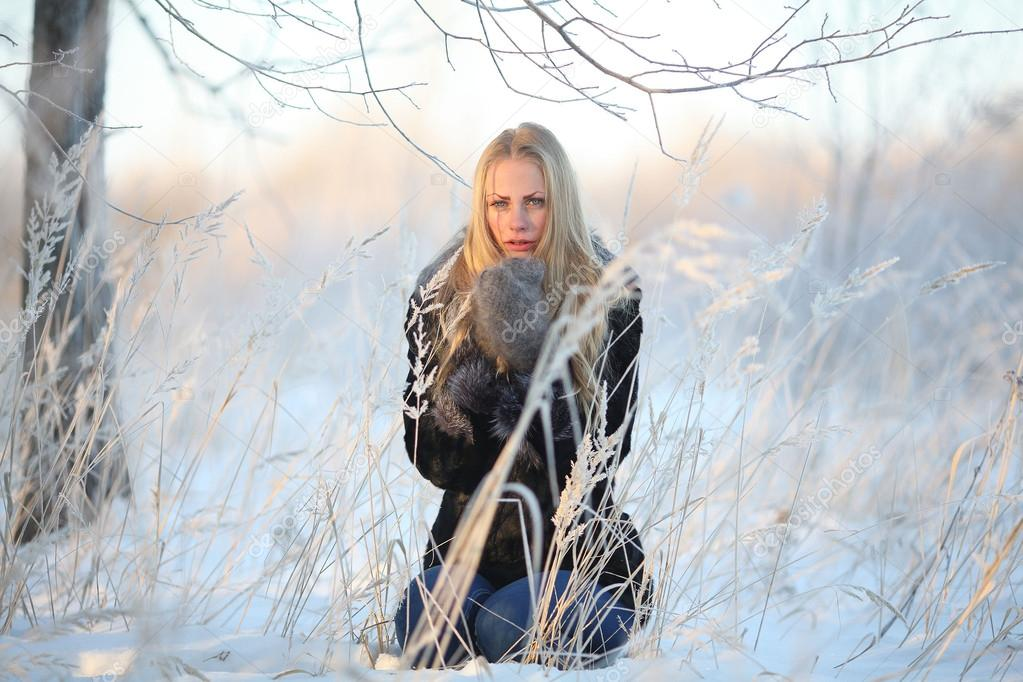Portrait of frozen girl beautiful blonde
