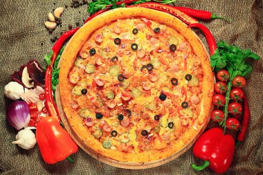 Pizza with vegetables and herbs