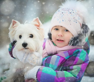 Girl with white dog