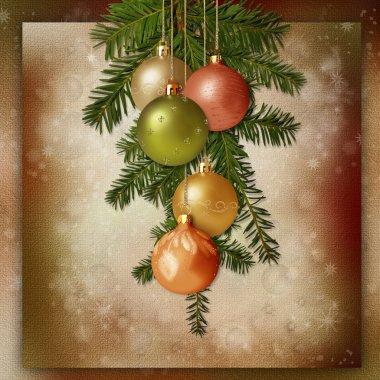 Christmas balls and spruce branches on a vintage background