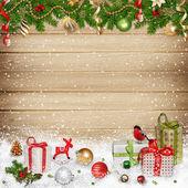 Fotografia decorazioni natalizie e regali su fondo in legno