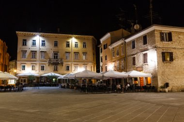 Illuminated Downtown in the City of Pula at Night, Croatia