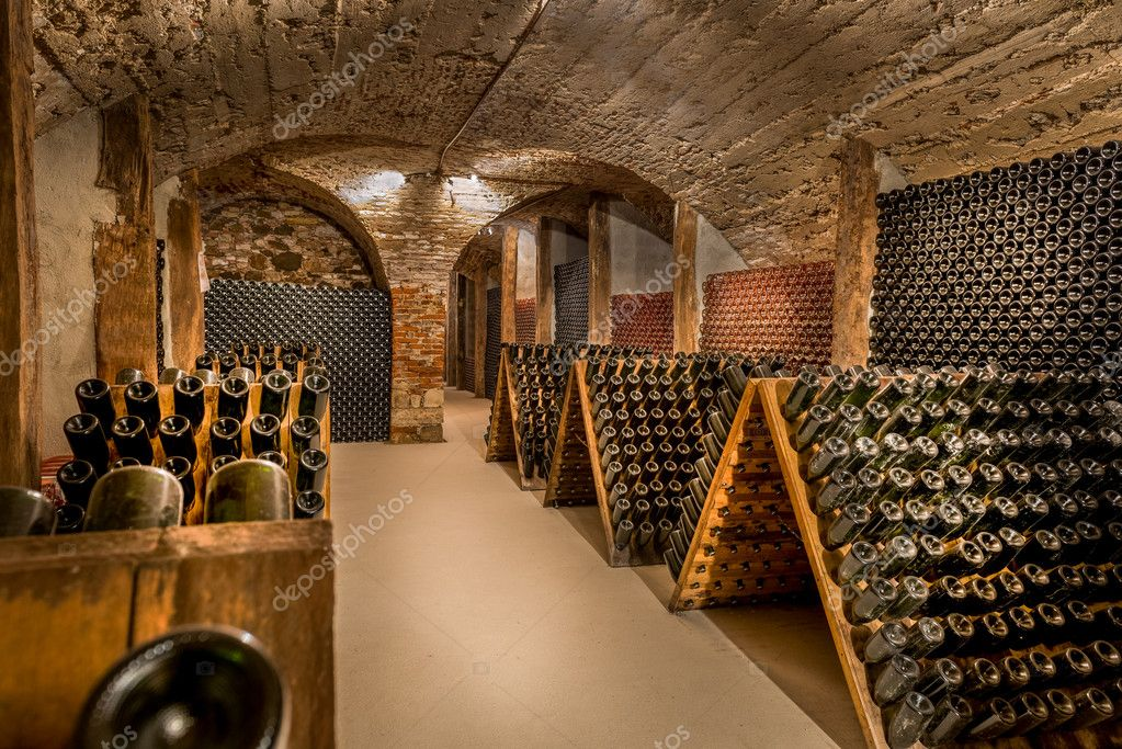 Wine cellar, a row of champagne bottles