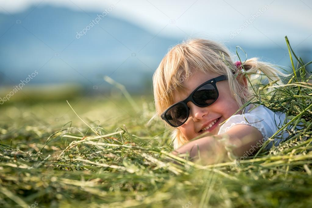 Beautiful young Girl Lying On The Meadow And Dreaming