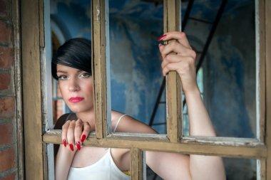 Young girl behind wood bars