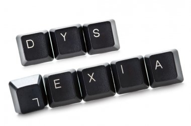 The word dyslexia spelled out in computer keypads stock vector