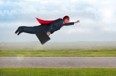 superhero businessman flying