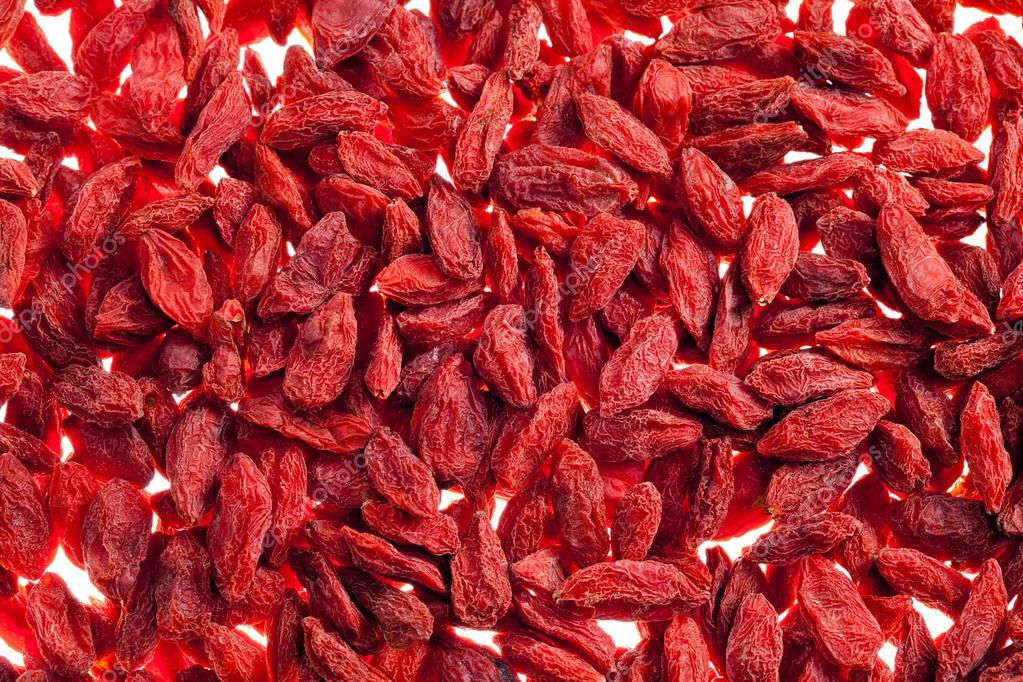 A lot of of red goji berry isolated on white background close up