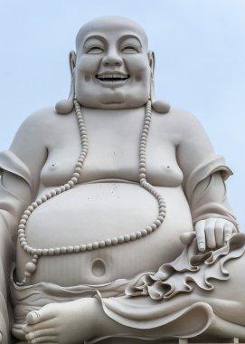 Portrait - Massive white sitting Buddha statue isolated from dec