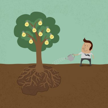 Business man watering idea tree