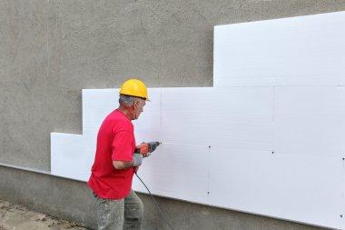 Construction site, styrofoam insulation drill