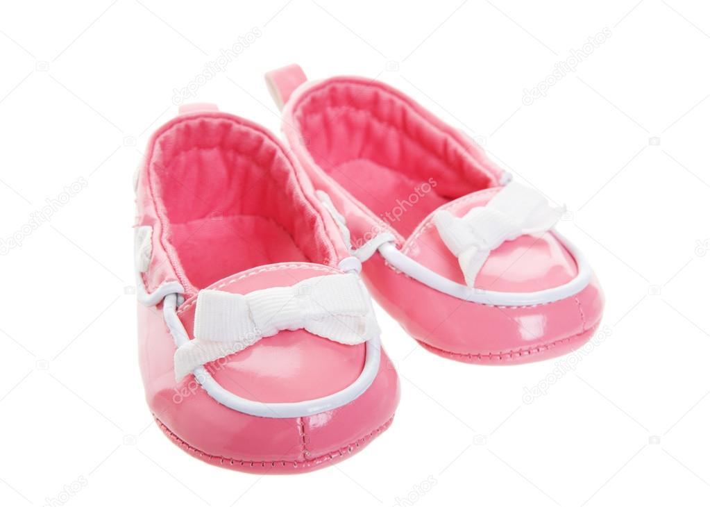 fd74330d1cb Ένα ροζ ζευγάρι παπούτσια φοριούνται μωρό. shot σε λευκό φόντο — Εικόνα από  ...
